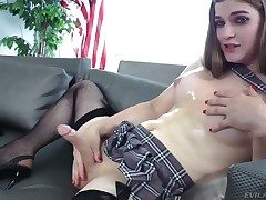 Alluring shemale Tiffany Starr considerably strokes her dick to the fullest dressed in a short skirt and