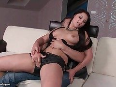 Chick in sexy leather cut-offs gives a lap dance