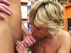 Sexy platinum-blonde mature nails him in the video store